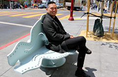 Michael Arcega sitting on one of his benches