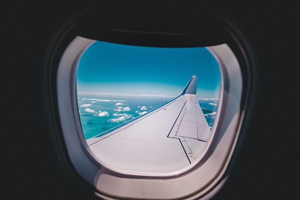 Looking out the window of an airplane